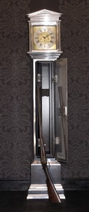 Clock with a secreted gun cabinet